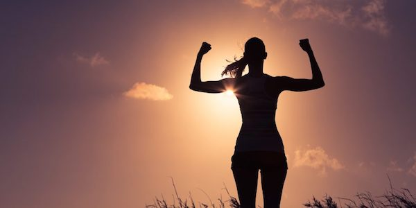 A female jogger runs outside to exercise good health for autoimmune disease